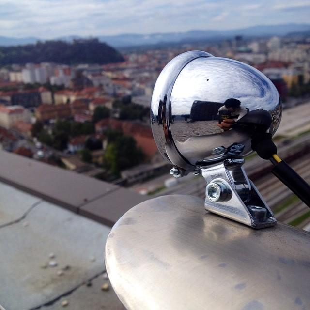 Rear light on #77c #rough #caferacer in background #ljubljana #oldtown and #castle #77 #7sevencustoms #topoftheworld